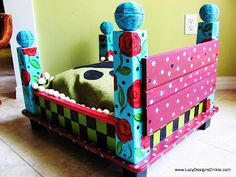 A really cute dog bed from an end table.  Wish I could paint like that!