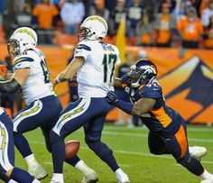 DE Elvis Dumervil forces a fumble as he sacks Rivers on the final play of the game. Broncos vs. Chargers 11-18-2012