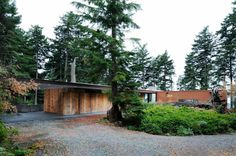 eagle ridge residence by gary gladwish architecture; nestled in. wood. shipping container? nature+mod. love.
