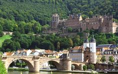 Heidelberg, Germany Castle on of the hill and the city bridge.