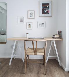 Natural wood and white with a beautiful wishbone chair.