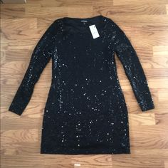 Sequin little black party dress Great for any party or event. New with tags! Size XS but can fit size small as well Express Dresses Mini
