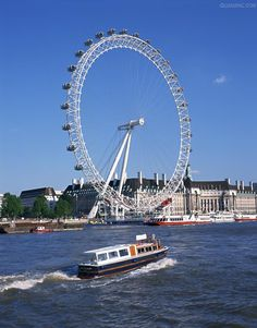 The London Eye going down the Thames.  The view of London was amazing on it.