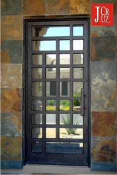 neat pattern for wrought iron storm door- could have solid black entry door or full glass entry door, or glass down to kick plate and silver kick plate