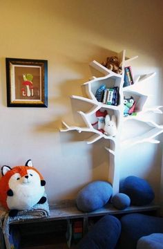 Tree Bookshelves....Kind of loving these rock pillows!