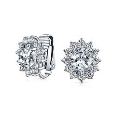 Bling Jewelry Oval CZ Bridal Clip On Earrings Crown Setting Rhodium Plated. Colored Stud Clip Ons. Clear, Blue, Green, or Red Cubic Zirconia. Brass. Measure: 0.59 inch L x 0.47 inch W. No Piercings Necessary.