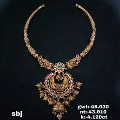 Stunning gold kanti necklace with chaandbali design pendant. Necklace with dancing peacock design. Necklace with pumpkin hangigns. Necklace studded with rubies and emeralds. Wedding Jewelry, Gold Jewelry, Jewelry Accessories, Jewelry Design, Jewellery, Emerald Necklace, Gold Necklace, Pendant Necklace, Princess Cut Diamonds