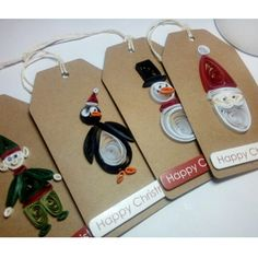 Quilled Christmas tags with Elf, Santa, penguin and snowman. Unique tags to brighten up your presents this Christmas! These are ready to post. #etsy #handmade #quilling #papercraft