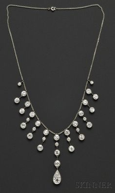 Edwardian Diamond Fringe Necklace, bezel-set with thirty-four old European-cut diamonds weighing approx. 13.50 cts., platinum topped gold mounts, later platinum trace link chain, lg. 15 3/4 in.   Estimate $8,000-10,000