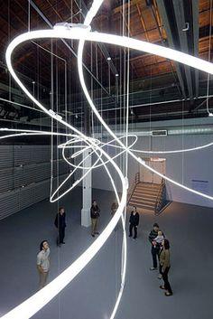 Lucio Fontana - Neon structure - An orbital-looking perspective of neon lights…