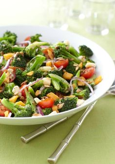 Marinated Broccoli-Tomato Salad- Since you can store this in the fridge up to 24 hours, this marinated salad with broccoli and tomato can be prepared ahead of time.