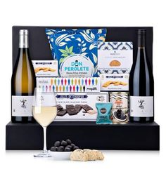 A duo of French red and white wines is presented with a tempting selection of European gourmet snacks and Belgian chocolates in an elegant gift box. A sophisticated gourmet gift idea for any occasion. Send Gift Basket, Food Gift Baskets, Food Hampers, Gift Hampers, Luxury Christmas Gifts, Buy Gifts Online, Christmas Gift Baskets, French Wine, Gifts