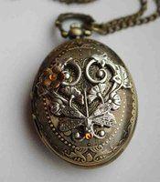 Fantasy pocket watch necklace by Pinkabsinthe