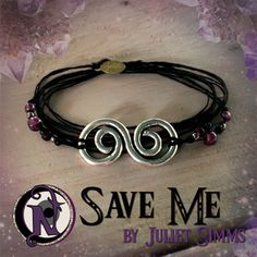 <b>Thread:</b> Black<b>Colored Glass Beads:</b> Garnet, Amethyst, Silver<b>Save Me Charm:</b> Tibetan Silver<b>Tag:</b> NTIO/<b>Juliet's Signature</b> (brass)<b>Size:</b> Fits All<b>Close-up Photo:</b> Not Actual Size<b>Juliet Simms</b> Front woman from the Warped Tour band <b>Automatic Loveletter</b> has released 2 records and 3 EPs on several labels including <b>Epic, Sony,</b> and <b>Paper and Plastic</b>. Her uniquely raspy and versatile voice has appeared singing duets with numerous…