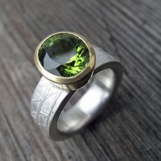 Peridot, 18ct gold and etched silver engagement ring.
