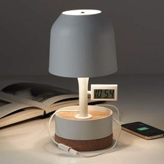 The Hodge Podge Alarm Clock Table Lamp is composed of a lacquered metal body and shade perched atop a cork base. http://www.ylighting.com/forestier-hodge-podge-alarm-clock-table-lamp.html