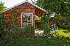 Garden Shed with Shaker Shingle Siding, Planting Beds, and Climbing Vines