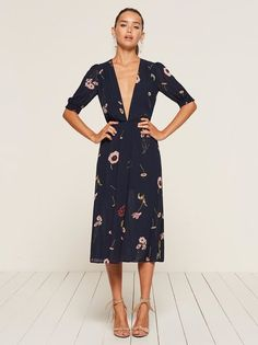 You've really blossomed. This is a midi length dress with elastic at the waist and smocking on the sleeves.