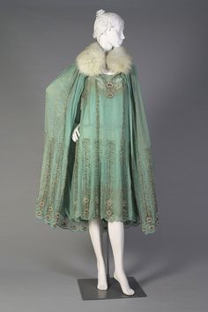 1920s, America - Teal chiffon and gold evening dress and cape with fur collar by Peggy Hoyt.