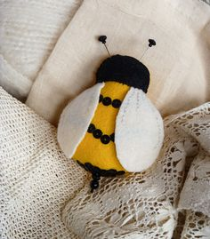 Bumble bee pin cushion - handmade from wool felt and complete pin antennae and stinger.