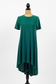 Our emerald high low dress is easy and effortless, with casual short-sleeves and a high neck that work well for all occasions. The front lands right above the knees while the back drapes mid-calf. It
