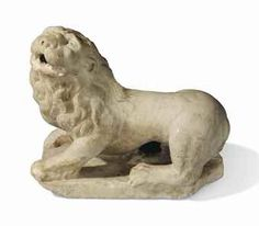 A NORTH ITALIAN WHITE MARBLE RECUMBENT LION VENICE, 16TH CENTURY