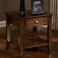 Standard Furniture 27682 Hialeah Court End Table by Standard Furniture. $196.73. French dovetail drawer construction throughout enhances durability.. Exotic hardwood color veneers contrast with each other for a dramatic appeal.. Hardware comes in two choices: eye catching nickel finish and wood finish.. Warm Cherry finish. 27682 Features: -End table.-Veneer application.-Contains some plastic parts.-Roller side guides.-Offers ample shelving and drawers for extra sto...