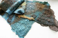 Nuno felted scarf in brown and turquoise. Photo by Jane Bo via Flickr.