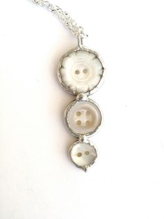 Button Necklace Recycled Jewelry 3 hanging mother of pearl Pendant MOP. $18.00, via Etsy.
