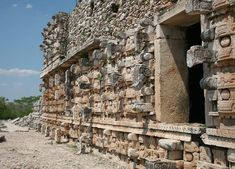 """Kabah (""""strong hand"""") is a very old Maya town on the Puuc route.   The most famous landmark at Kabah has the English name Palace of the Masks and the Maya name """"Codz Poop"""", which means """"rolled mat"""" in the local dialect."""
