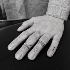 Delicate finger tattoos by Oliver Whiting