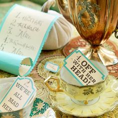 """Game? Who was it that said """"Off with her head!"""" -- the Queen of Hearts or the White Rabbit? Entertain guests with a quirky quotation matching game that's simple to put together. Print our free list of characters onto cardstock and cut out. Mount it on a rectangle of turquoise cardstock cut with deckle-edge scissors."""
