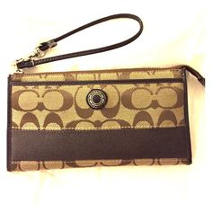 Authentic Coach Signature Stripe Wallet/Wristlet Authentic Signature Coach Fabric wallet / wristlet with brown stripe on the outside. Inside: 6 card inserts, 3 big pockets and extra space for more storage. Front outside: 1 open pocket. Back outside: 1 zippered pocket. Also inside bottom: fabric is torn (see picture), but everything is in place. Coach Bags Clutches & Wristlets