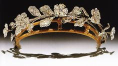 Diamond tiara in the form of wild roses and carnations, flowers en tremblant.  Composed of 2 early 19c jewels, it's said to have belonged to Lady Caroline Lamb and was rearranged in the late 19th C.  (From Munn's Tiaras Past and Present)