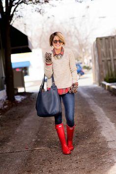 Raincoats, jeans, neutral sweater, plaid shirt, statement necklace.