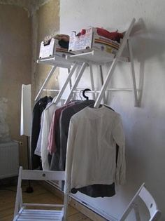 Need extra closet space? Build one out of a folding chair. | 53 Seriously Life-Changing Clothing Organization Tips