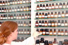 pharmacist pulling bottles off the shelves of apothecary