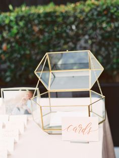 Gorgeous glam glass gold framed card box: http://www.stylemepretty.com/2016/09/23/london-west-hollywood-rooftop-wedding/ Photography: Carmen Santorelli - http://carmensantorellistudio.com/