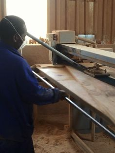 12. Large panels and table tops move on to the stroke sander where surfaces are machined to smooth level finish. We prefer the crafted feel stroke sanding achieves to the clinical perfection of drum sanders used by other makers.