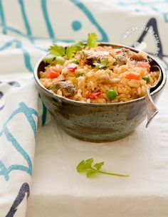 Locrio de Pica-Pica Recipe (Rice and Spicy Sardines): Considered a poor man's meal, and a favorite of informal get-togethers, I love its strong tastes.