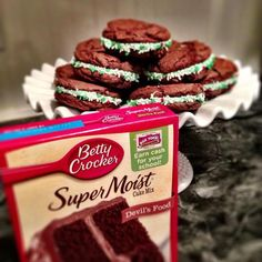 Christmas Whoopie Pies! In stand mixer, Mix Devil's Food cake mix, scant 1/3 c oil, and 2 eggs. Dough will be thick and slightly sticky. Roll dough into golf ball sized balls and place on cookie sheet. Flatten. Bake at 350 for 8-10 minutes until tops crackle and look dry. Cool 1 minute and move to cooling rack. Generously frost bottom of one cookie then top with another. Roll edges in sprinkles if desired. One recipe makes about 10 large Whoopie Pies.