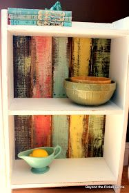This shelf started as a cream shelf with some hunter green colored ivy stenciled all over it. I painted it white, a couple coats were neede...