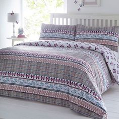 Add a burst of colour to your bedroom with this duvet set from The Collection. In a soft cotton blend, this set includes an array of vibrant prints the perfect contrast to minimalist d cor.