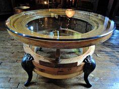 Port hole shaped window into a coffee table