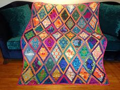 """based on Kaffe Fassett's pattern """"Bordered Diamonds"""", a quilt with All The Colors."""