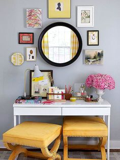 Vanity Flair: The sleek but hardworking desk stows home office supplies in one drawer and makeup and jewelry in another. Pullout benches for the dressing table are better than a single chair -- each works as a seat or a table. An eclectic gallery of art arranged around the mirror furthers the vanity area's own unique style blend.