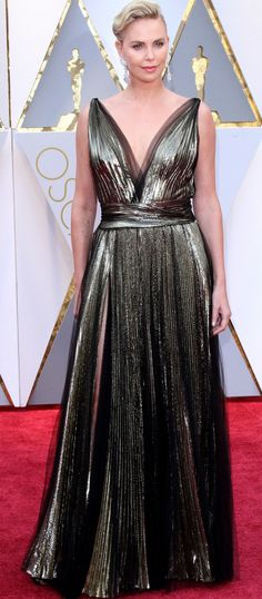 Charlize Theron wearing a Christian Dior gold lamé gown at the 2017 Academy Awards