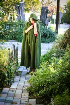 Another pic of Mia in the cloak. @ http://www.ravelry.com/projects/marla3206/long-hooded-cape