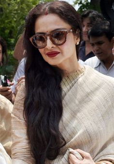 "New Delhi :  Popular actress Rekha, who was nominated to Rajya Sabha in 2012, on Tuesday attended the house for the first time during the ongoing Monsoon Session. Draped in a yellow saree, the actress joined the upper house after lunch and remained there for some time. Two Congress members came and interacted with her after … Continue reading ""Rekha Attends Rajya Sabha After A Long Time"""