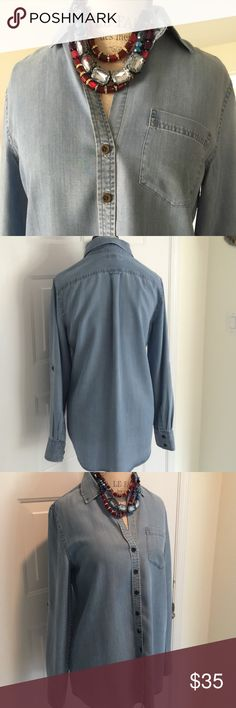 Banana Republic Boyfriend Shirt Banana Republic chambray oversized Boyfriend Shirt  button front and one pocket the sleeves do have atoll tab Gently worn one time Excellent condition Cleaned and ready to wear ❌trades❌PayPal Banana Republic Tops Blouses